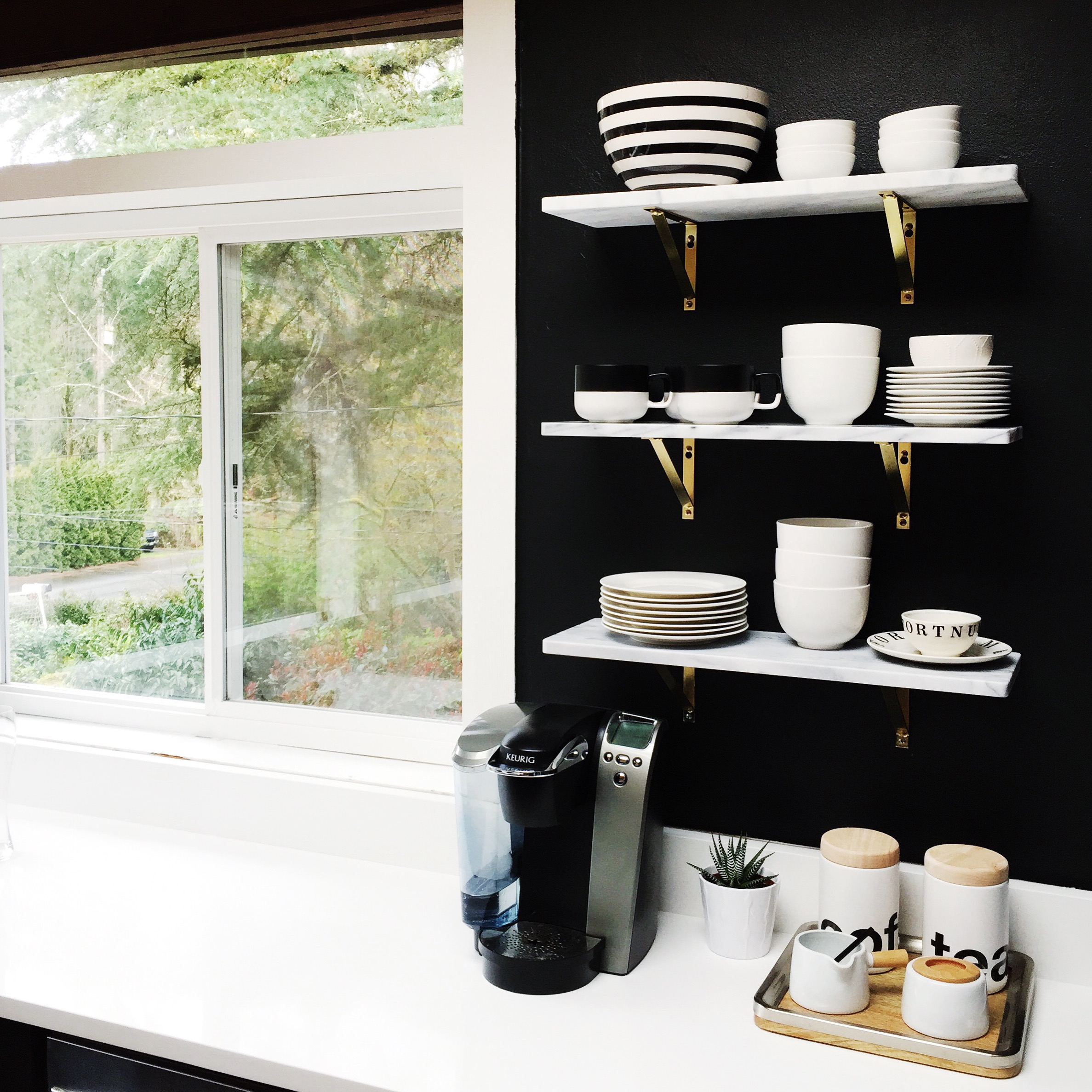 Open shelving & a black and white colour scheme add to the modern kitchen.