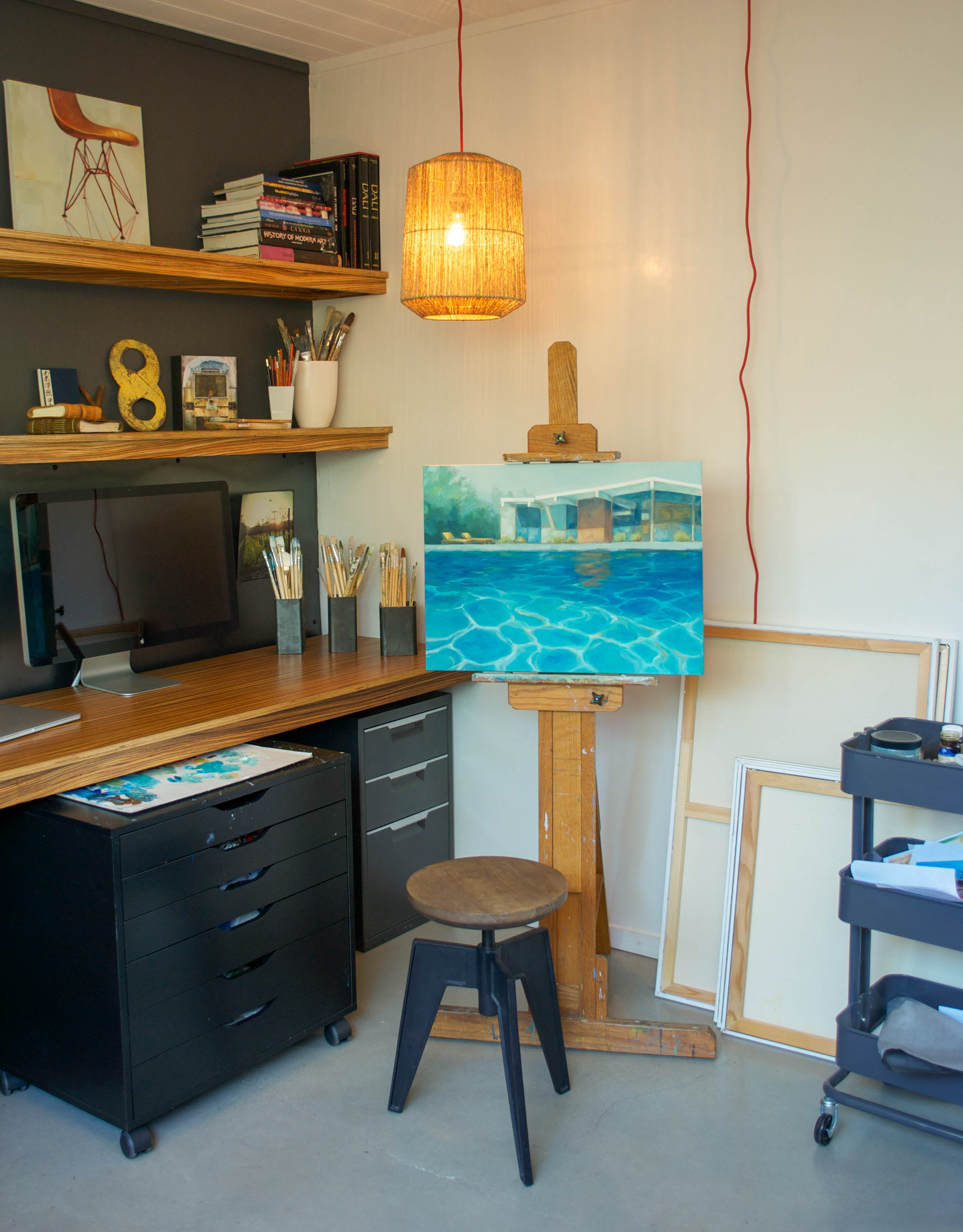 I mentioned to Laura that I know we would hit it off in person as we have the same art books filling our shelves. I adore the pendant that hangs above her easel & this painting truly captures the California lifestyle that Laura is inspired by.