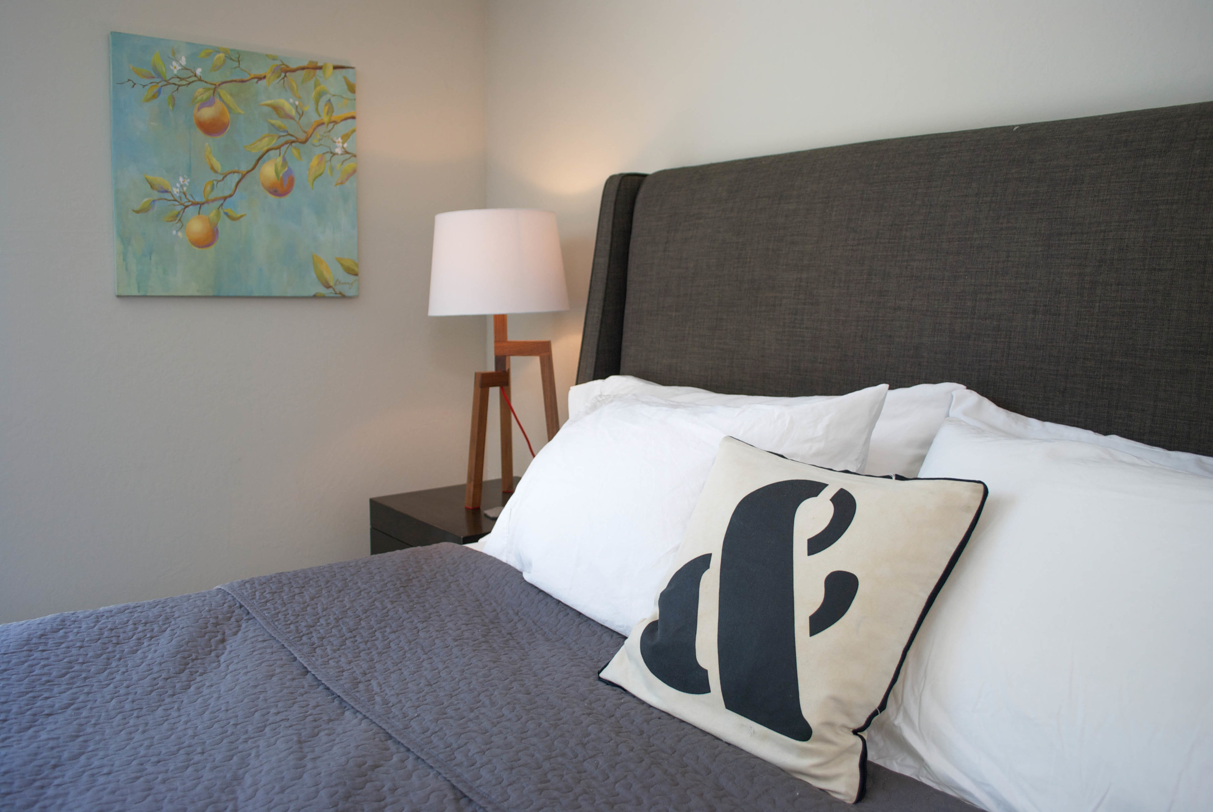 One of Laura's paintings adds a splash of colour to the neautral palette.