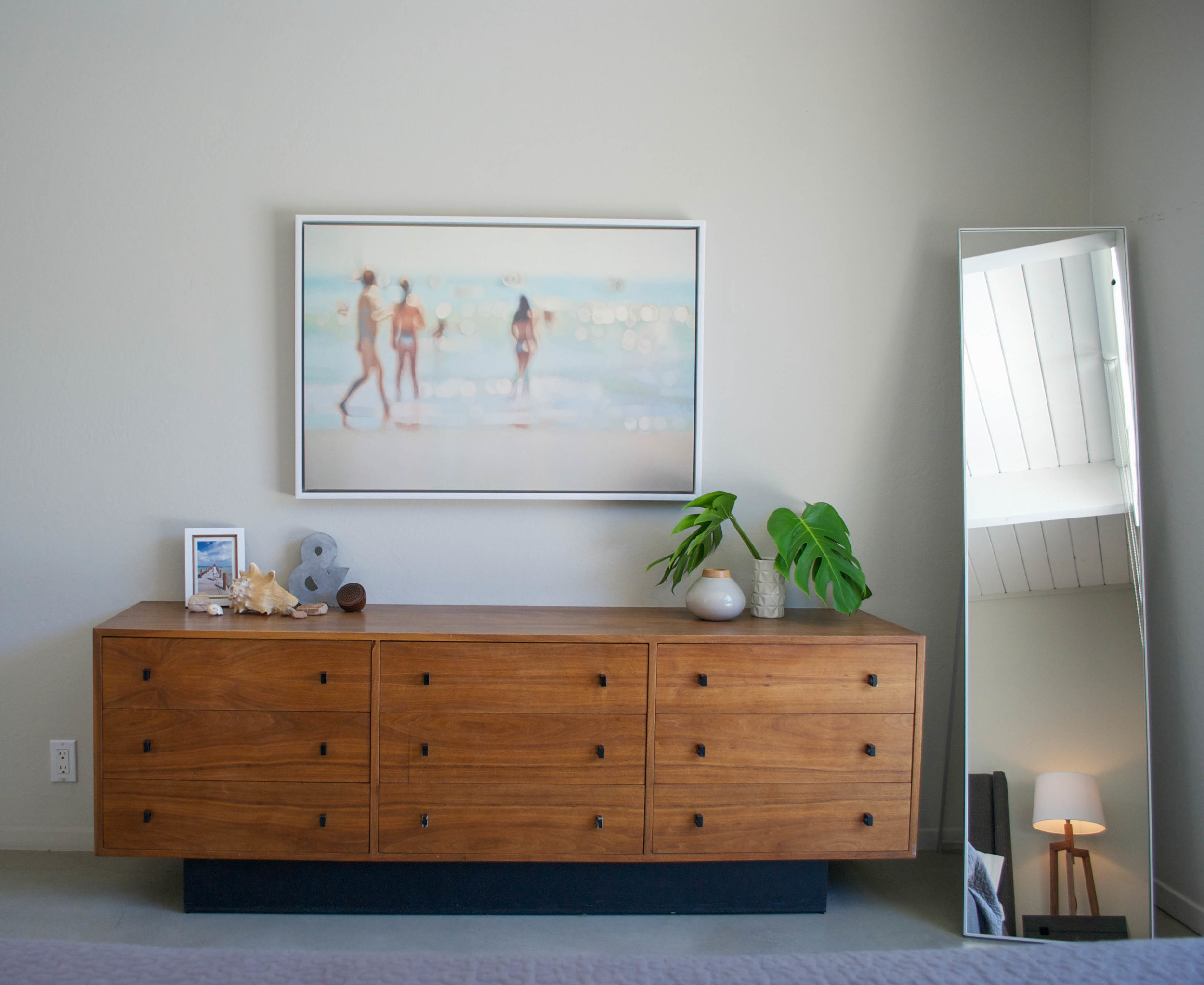 A painting by Philip Barlow is a focal point above this vintage dresser that belonged to Laura's parents.