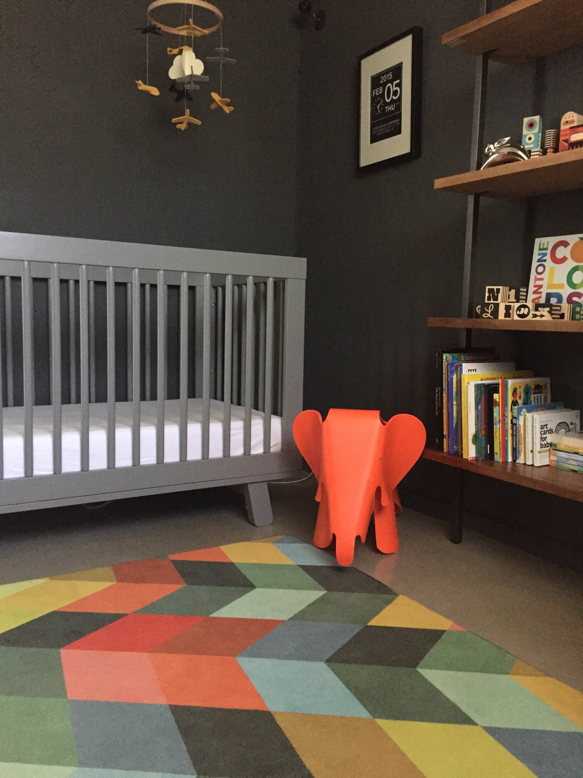Lincoln's bedroom is a great example of a timeless design that will grow with him. The colourful modern rug softens the space and creates an area for play.