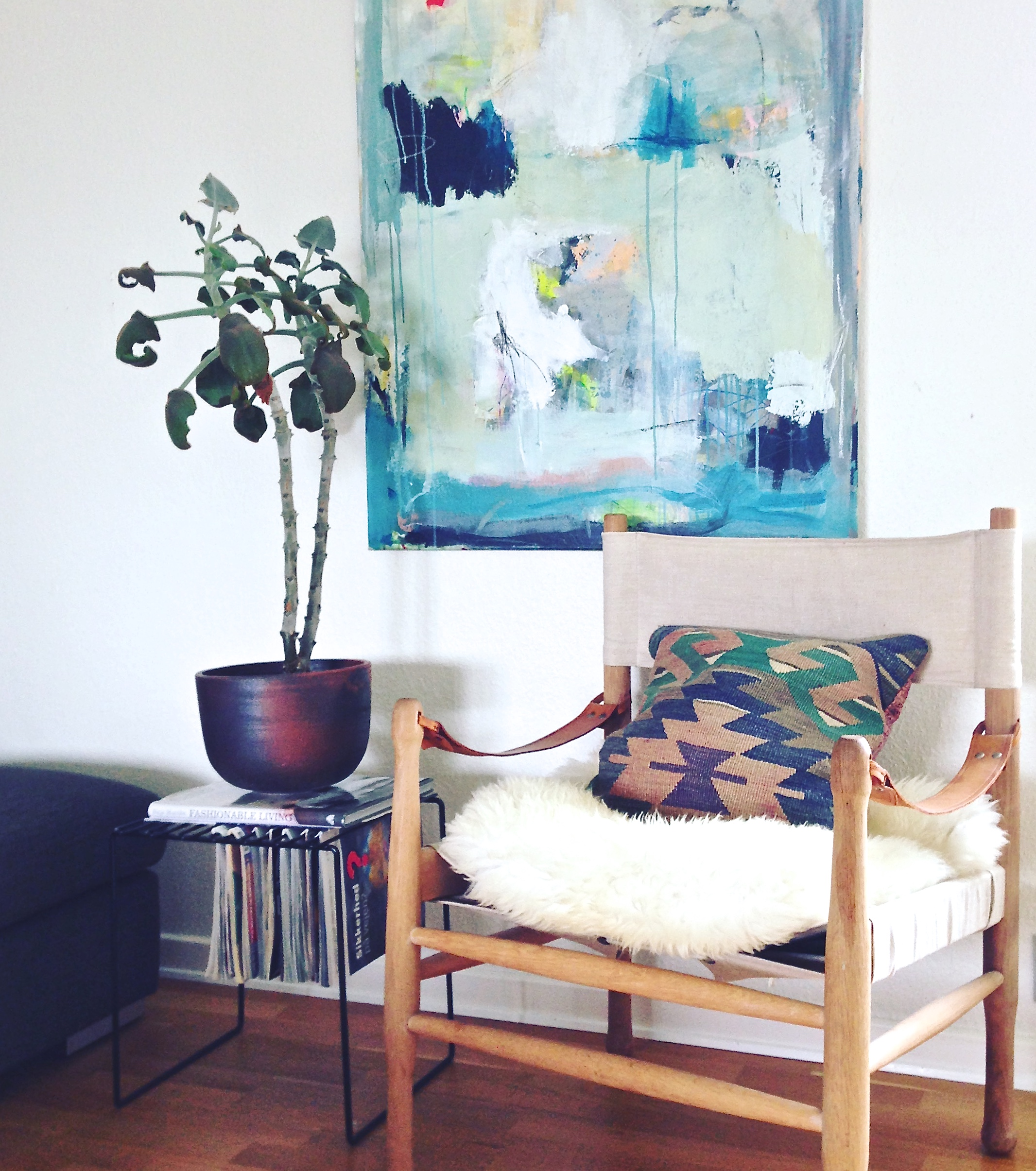 Line's grandfather was a cabinet maker and hand crafted this chair for his wife. After she passed, this family heirloom became a special addition to Line's home. Her colourful artwork makes this corner in the family room so welcoming.
