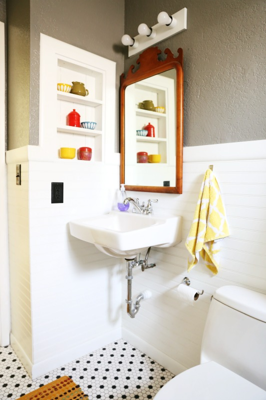 """We went with a floating sink to open up this tiny bathroom."""
