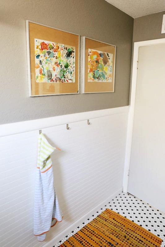 Who says you can't have artwork in the bathroom? These colourful pieces are by Beth Allan Art.