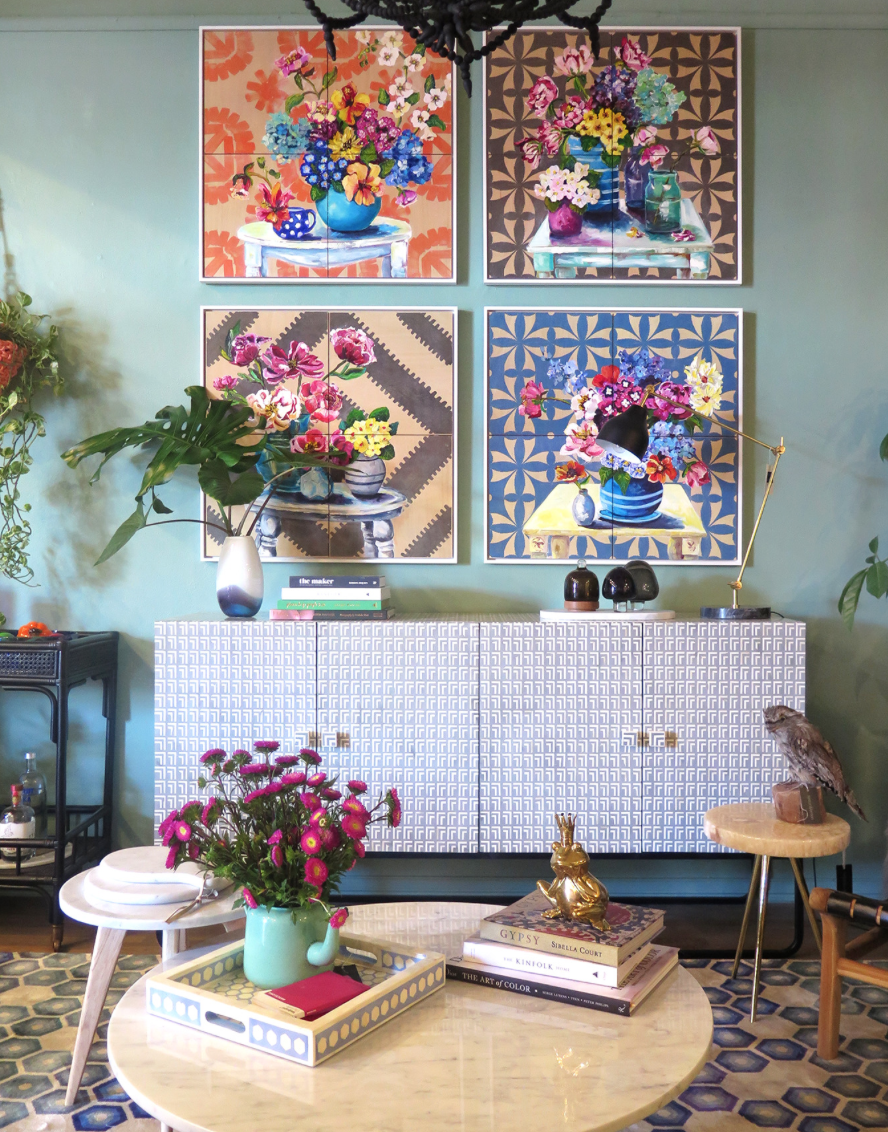 The graphic patterns in the work of Ali Wood are a modern juxtaposition to the floral arrangements. I think they look wonderful grouped together in this vignette.