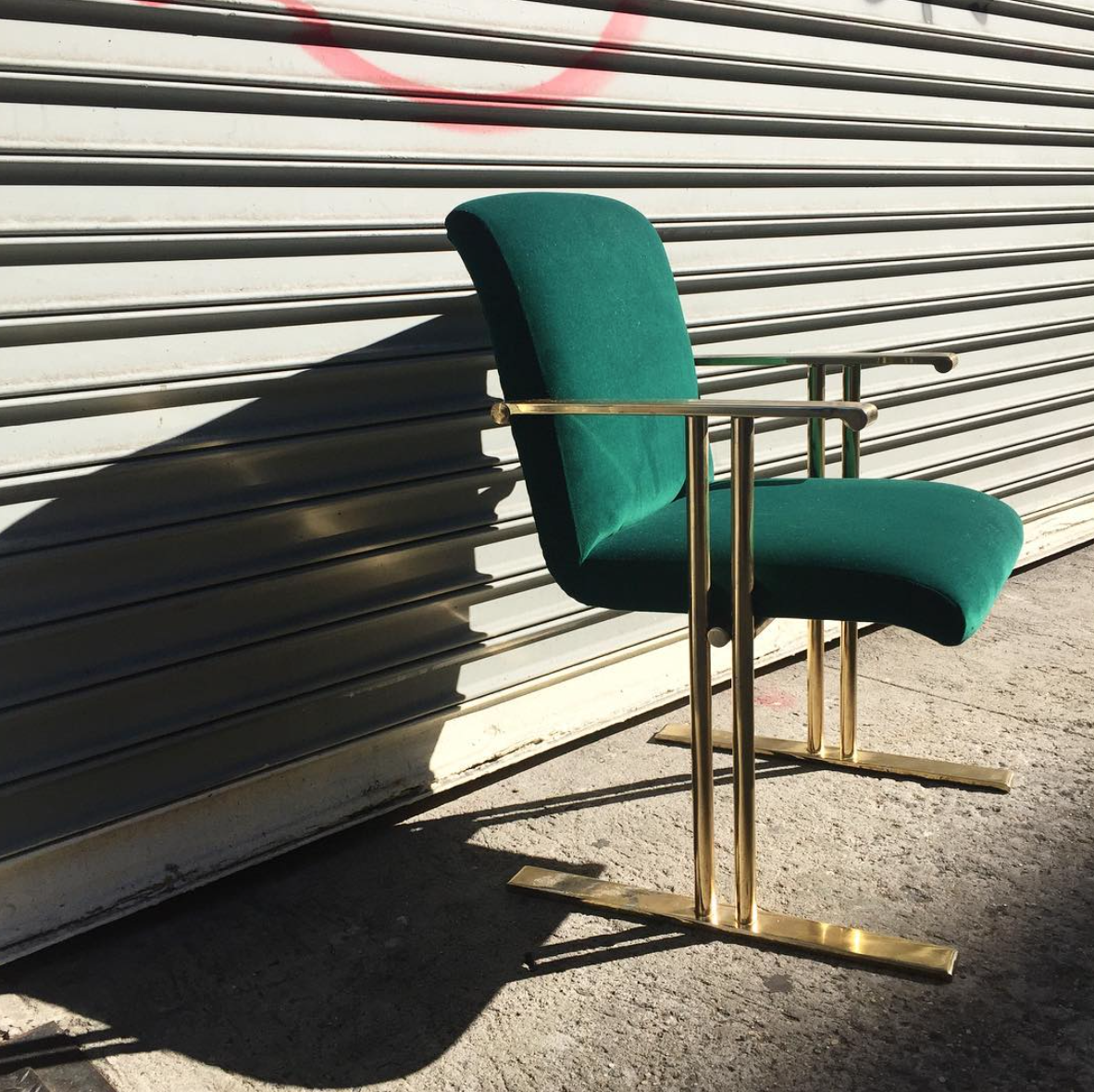 A vintage 70's brass chair got a makeover with this emerald green velvet.