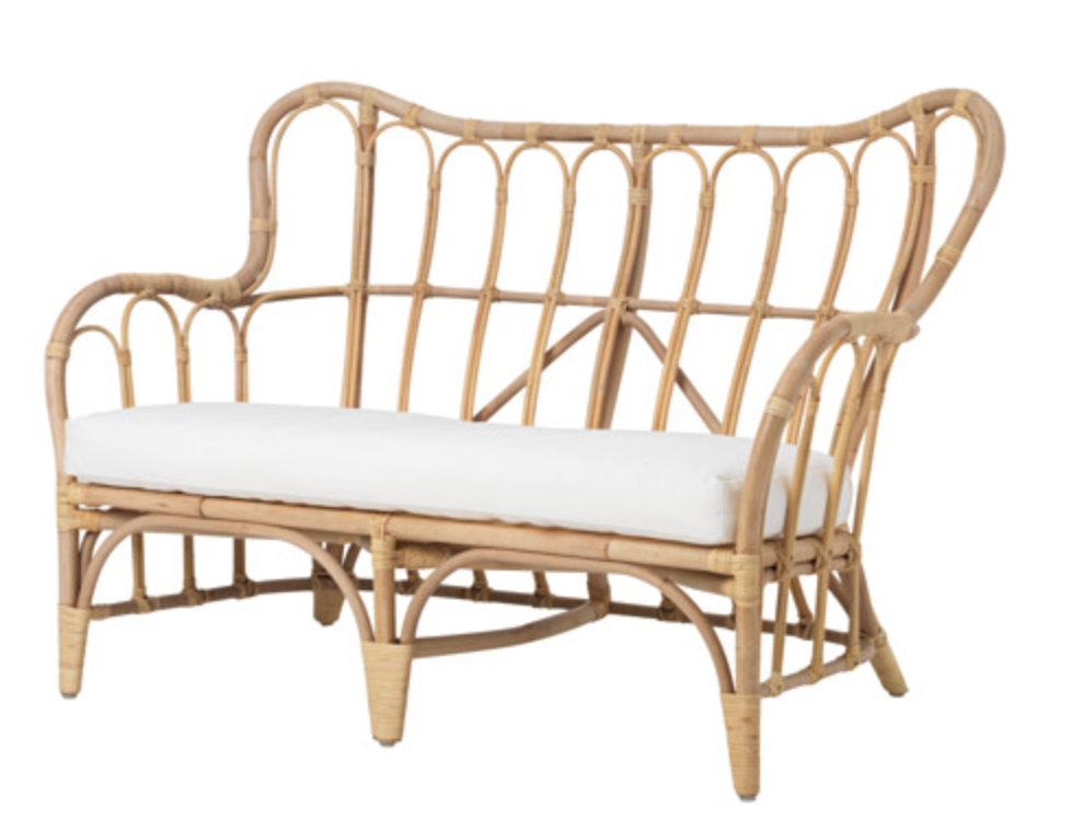 Ikea's Mastholmen collection has some great pieces like this  loveseat.  With the popularity of rattan you could style it in an indoor or outdoor space.