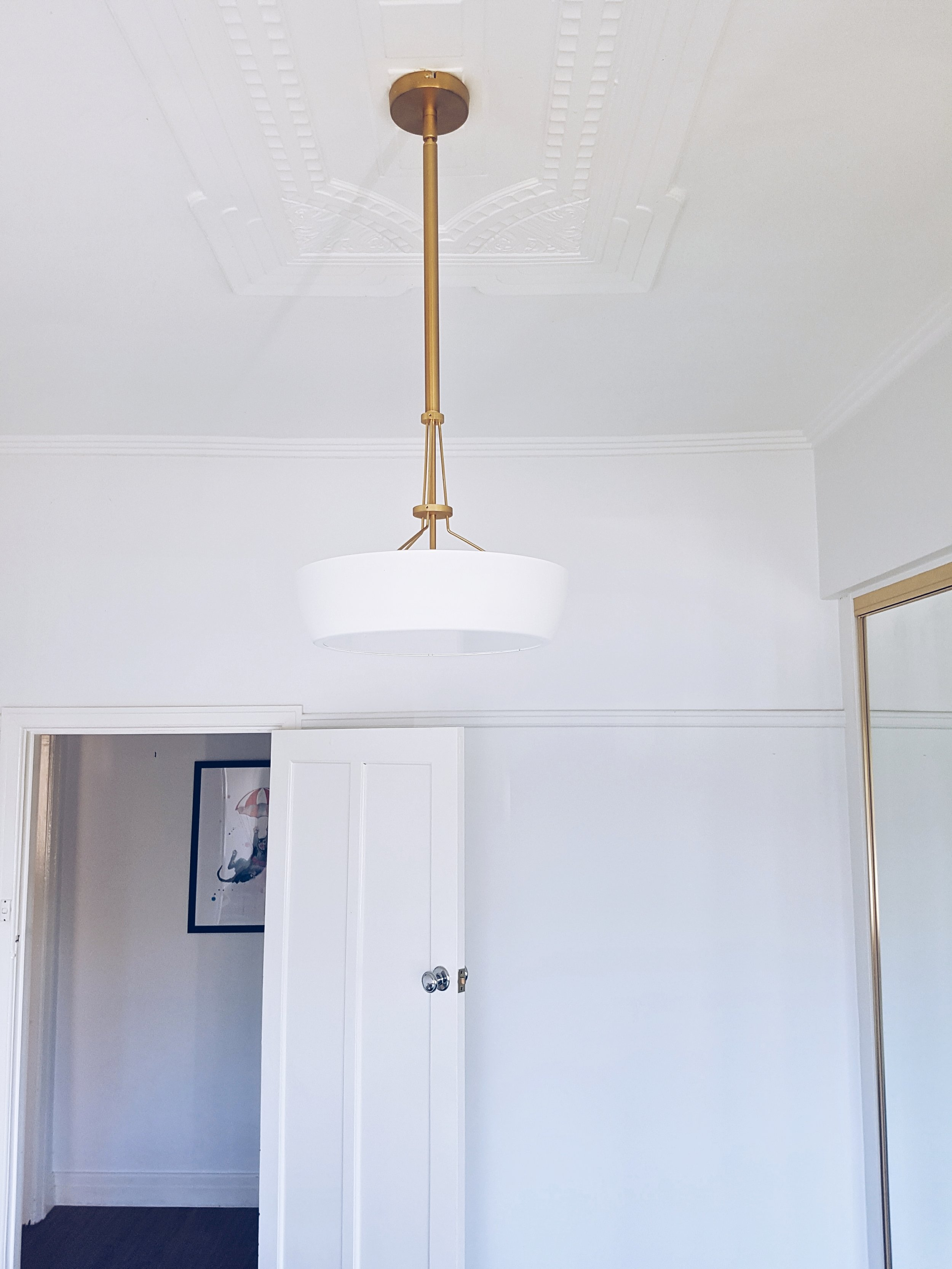 """I replaced the pendant light with a brass art deco pendant that took months to track down, creating a sense of nostalgia."""