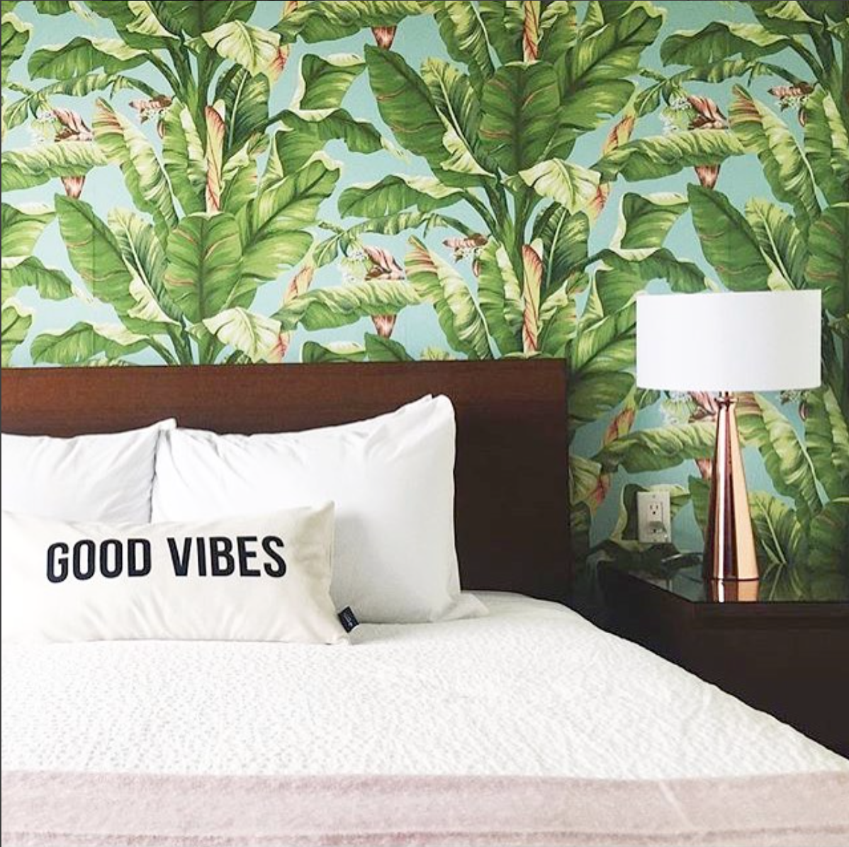 This was my side of the bed. My friend Lesley at  Swell Made  designed the pillows in many of the rooms, check her out. Here is proof of the power of wallpaper, can you imagine how plain the focal wall would look without it?