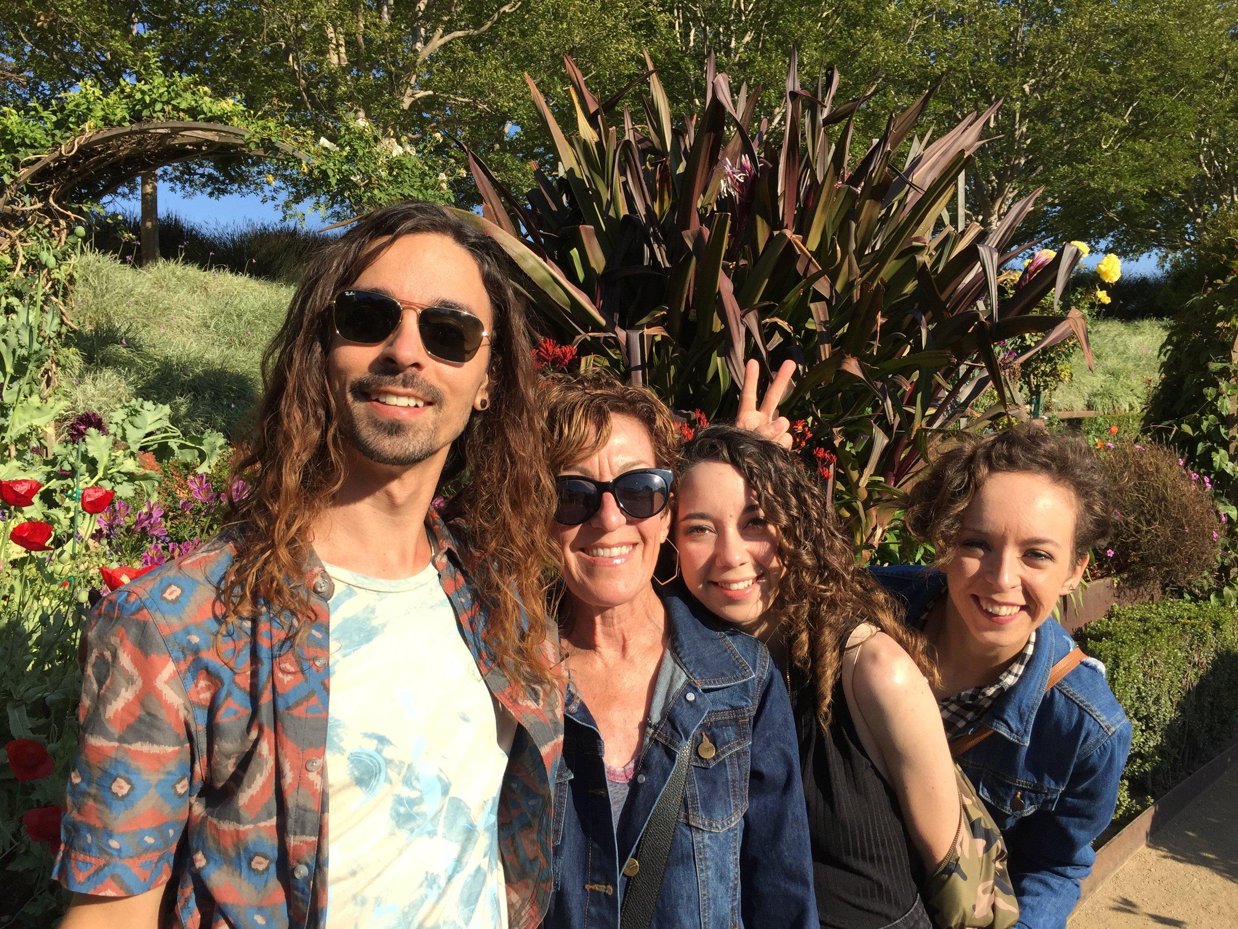 Kia snapped a photo of Jason, my mom, Claire and I soaking up the garden.