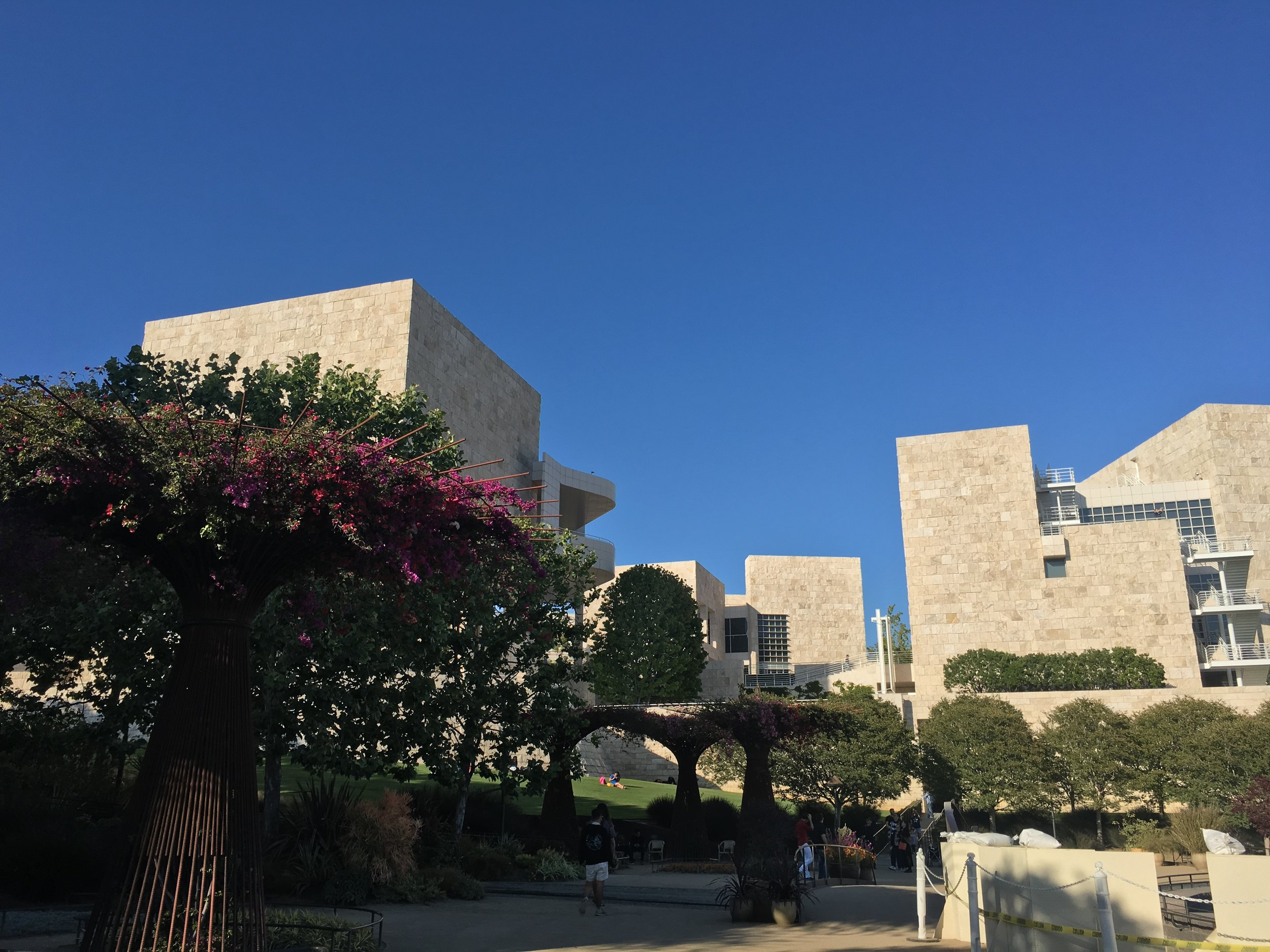 The Getty gardens contain numerous flowers, other plants,fountains, and quotes engraved on some stepping stones.