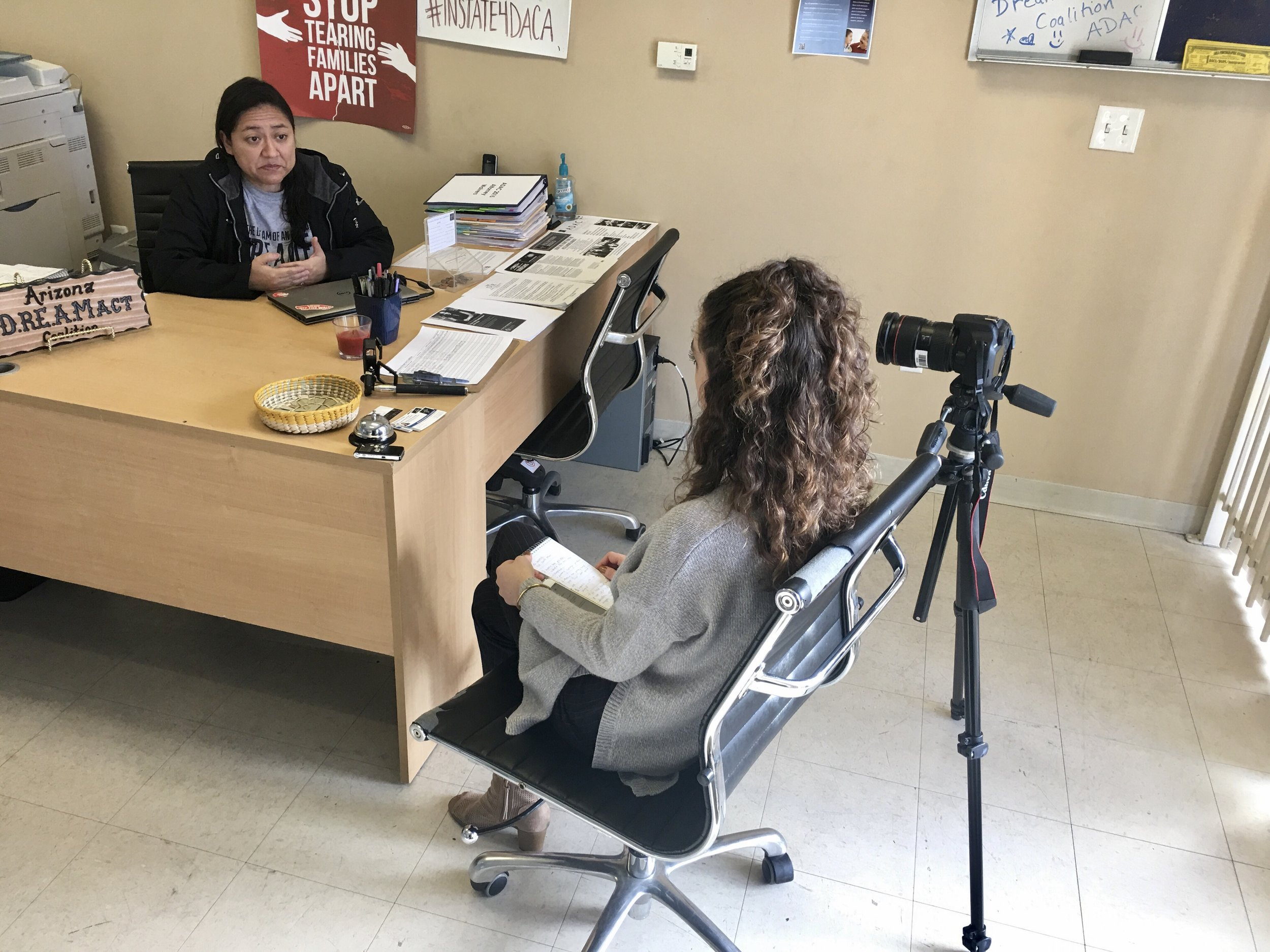 Interviewing Karina Ruiz, president of the Arizona Dream Act Coalition, about breaking DACA news on assignment for Cronkite News. (Photo by Lillian Donahue)