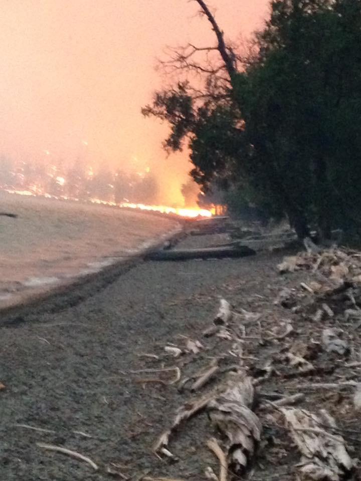 Fire coming ashore at Lake McDonald.