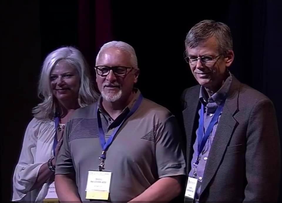 Lori giving Doug Braithwaite his Quick Draw award with OPA President, Kurt Anderson (right).