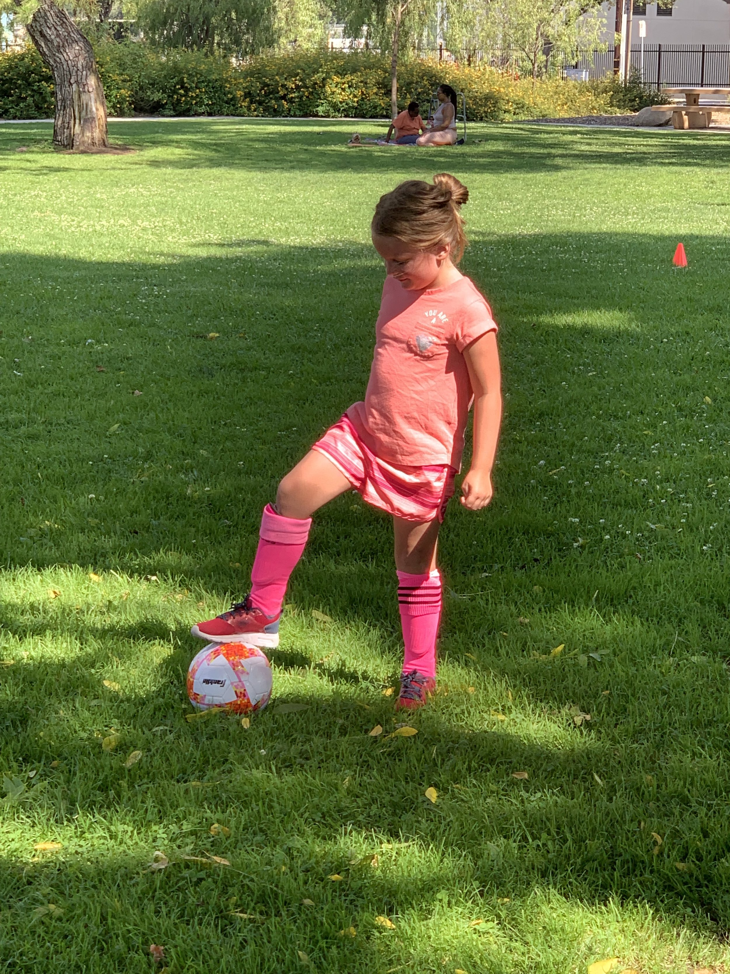 Ella playing soccer.