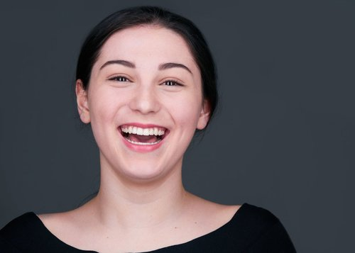 Young Actress Headshot Black clothing laugh