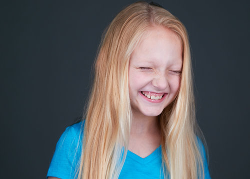 Child actor theater headshot laughing