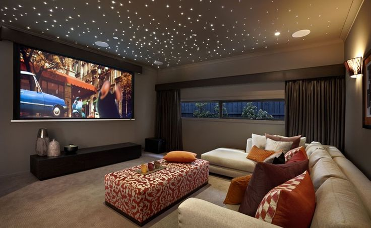 basement media room with starry ceiling
