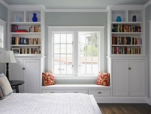 white bedroom with a window seat