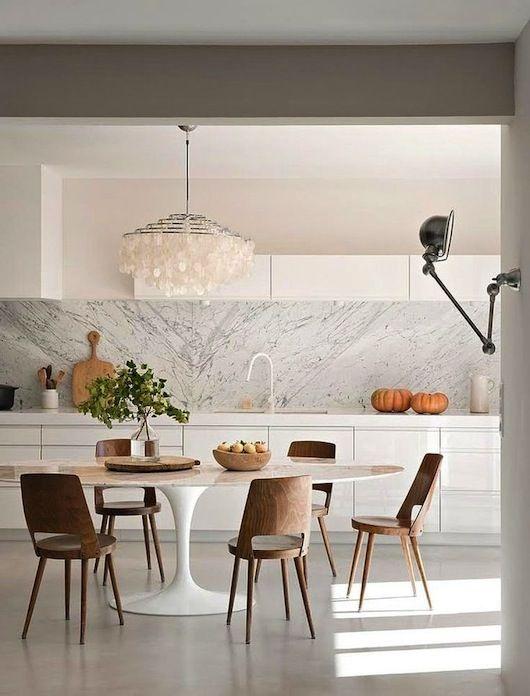 Nordic white kitchen with marble splashback