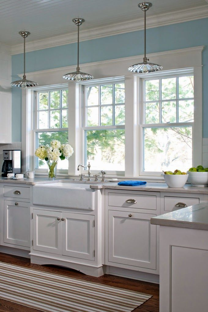 white and blue kitchen with shaker cabinets