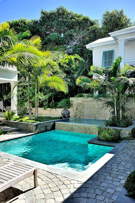 Small geometric pool with tropical gardens