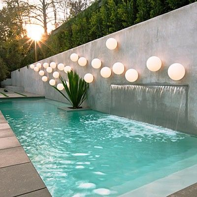 narrow pool with cascading wall
