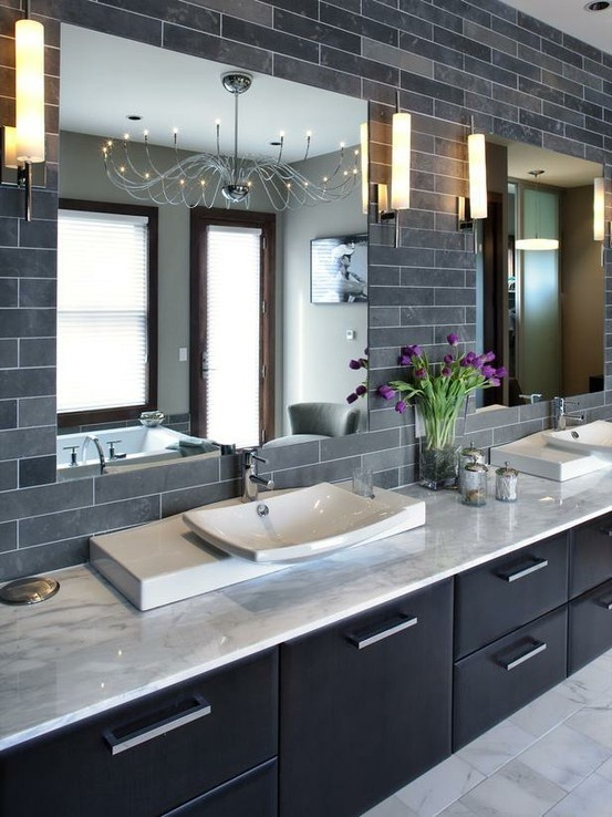 luxurious bath with marble countertop