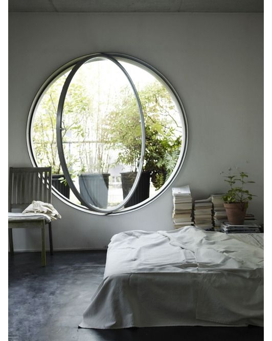 bedroom with porthole