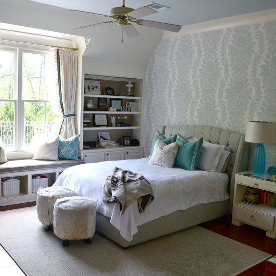 white and turquoise bedroom with a window seat