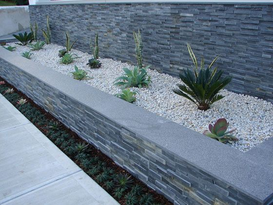 modern pocket garden with white peebles