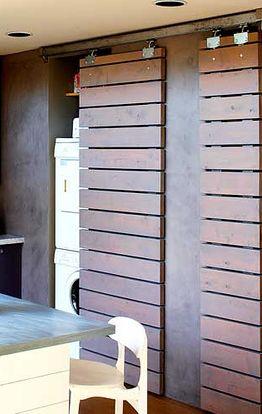 laundry with sliding barn doors