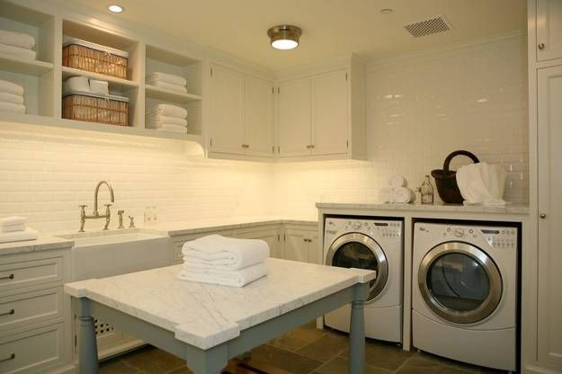 spacious laundry room with folding island