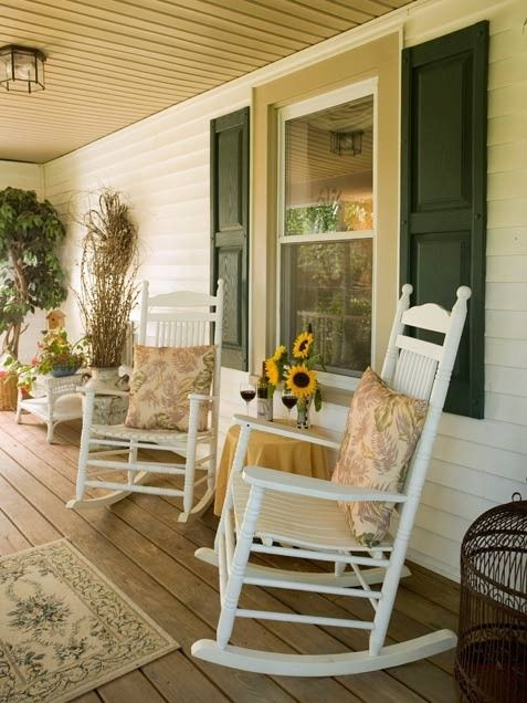 old country verandah with rocking chairs