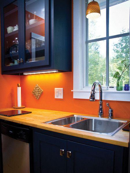 new modern orange and navy kitchen