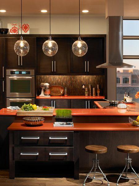 brown kitchen with orange countertops