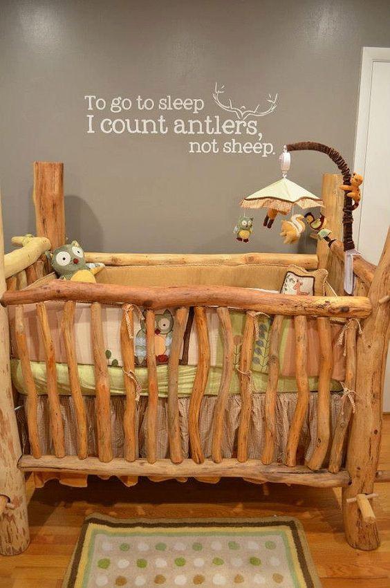 rustic log crib in nursery room