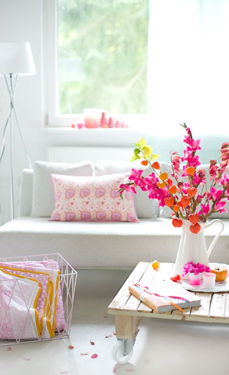 bright flowers in white living room