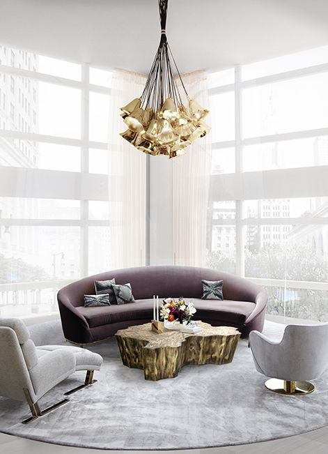upscale living room with golden bells chandelier