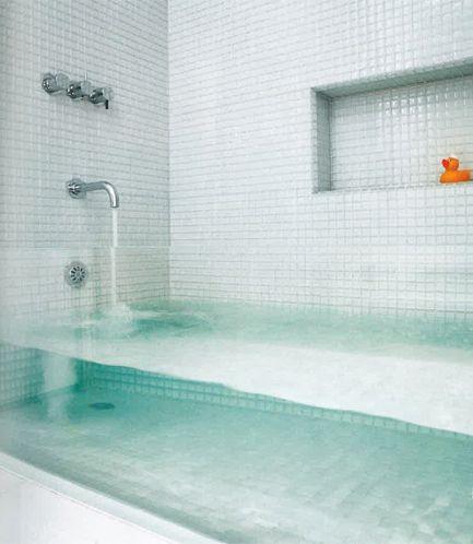 transparent glass bath tub