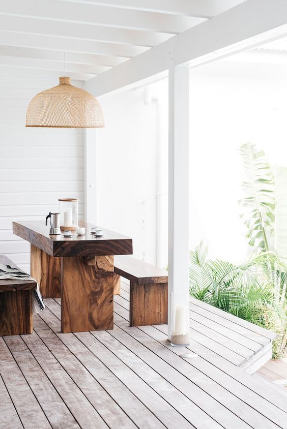 white deck with wooden dining set
