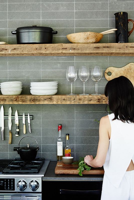 modern kitchen with rough wood floating shelves