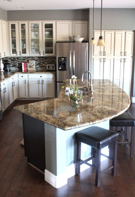 elegant kitchen with curved island counter