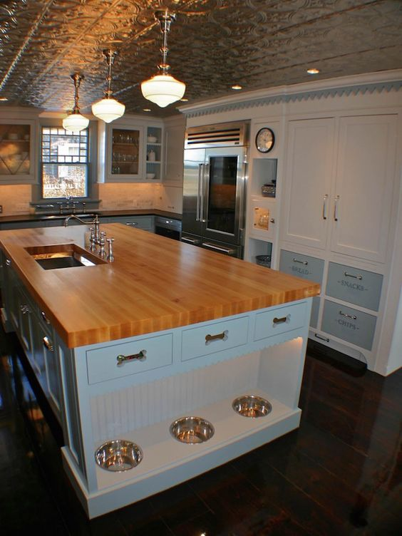 butcher's block kitchen island with pet feeding station