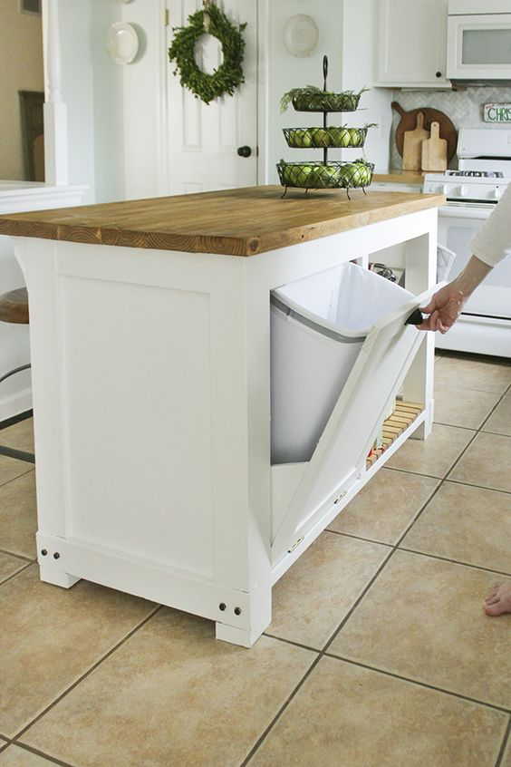 kitchen island with swing out garbage bin