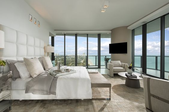 master bedroom with glass walls
