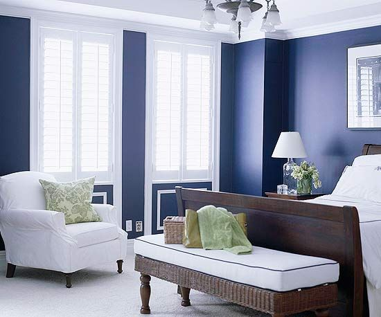 elegant bedroom with blue walls