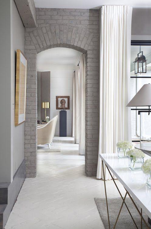 grey arched brick doorway