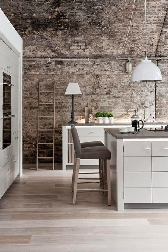 modern kitchen with aged brick wall
