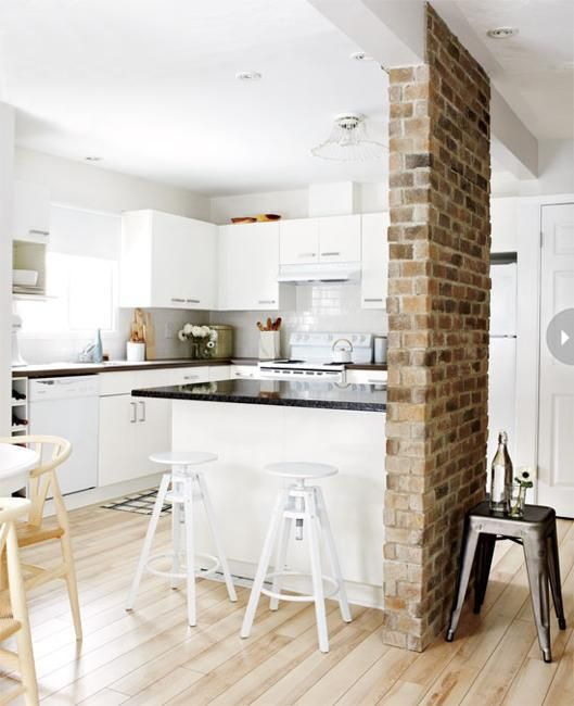 cottage kitchen with brick room divider